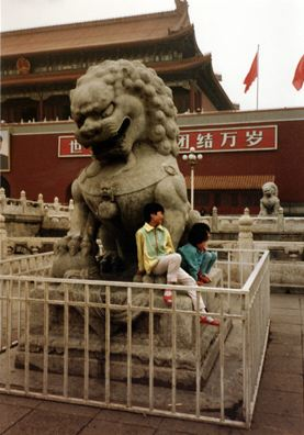 BEIJING: Kids on a lion sculpture in Tienanmin Square, near the entrance to the Forbidden City.