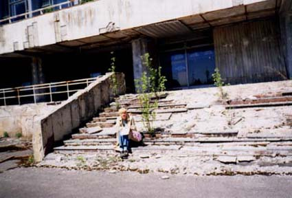 On the steps of the Palace of Culture; rather, on what remains of them.