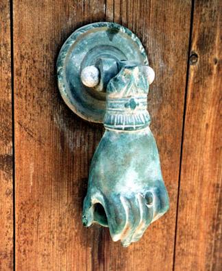 NAXOS: Traditional hand-shaped door knocker.