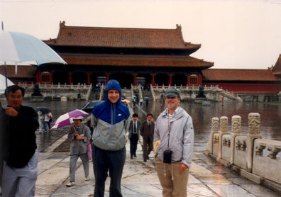 BWIJING: We made a hasty trip to the Forbidden City in the rain. Here are Tom and Terry in front of the building used as the backdrop in the opening scene of The Last Emperor.