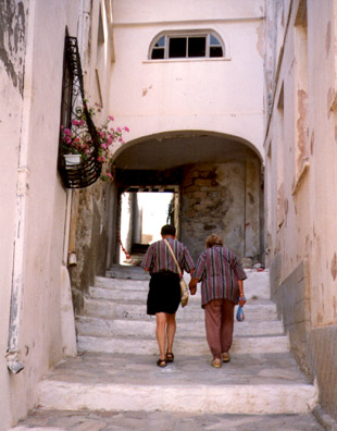 NAXOS: Mimi and Howard climbing steps up a steep street.