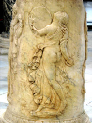 SEVILLA: Carved on a pillar, she dances in Dionysian ecstasy playing a circular drum. In the Sevilla Archaelogical Museum.