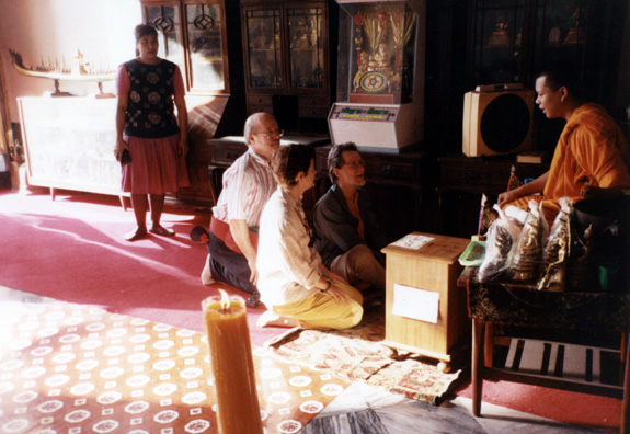 Terry Cook, Deborah Haines, and David Thorndike consult with a Buddhist monk in one of the Wat Po complex temples.