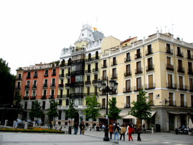 MADRID: Scene in a plaza in front of some attractive apartment buildings.