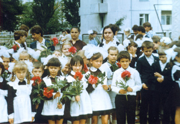 Sasha Sirota with his fellow pupils near school No 1 (He is the boy in the front row on the right, holding the flower.)