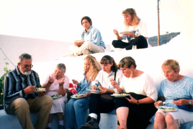 AMORGOS: Serious eating at Marcia's party (she's the one all dressed up, second from the right).