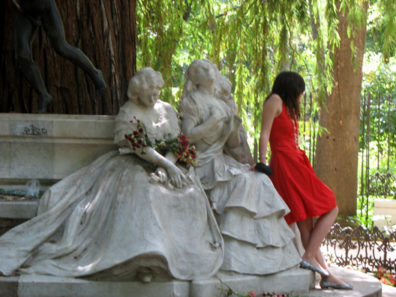 SEVILLA: A young girl poses with the group of mourning female relatives at a sculpture in memory of a Spanish poet in the Parque Maria Luisa, Sevilla.