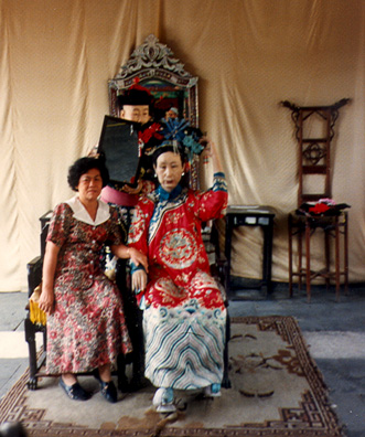 SUMMER PALACE: Tourists posing as members of the imperial court. (2)