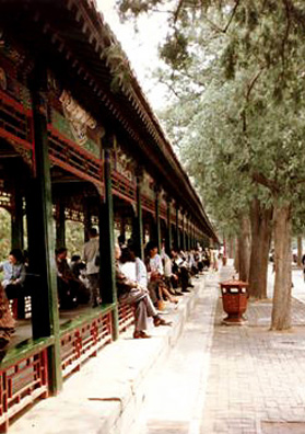 SUMMER PALACE: The world's longest covered walkway, connecting buildings in the Summer Palace, intricately painted with pictorial designs, often displaying Western influence, European perspective.