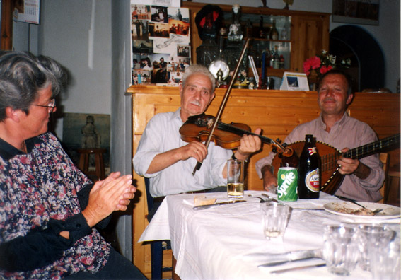 AMORGOS: That night Catherine had arranged a traditional roasted goat feast for us at Niko's taverna in Langatha (where earlier we had had a fabulous baked eggplant dish). Wonderful traditional music was provided by Stefanaiki (fiddle) and Michali (lauta).