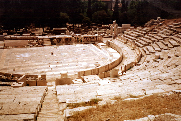 ATHENS: June 8, after sleeping in, we found the Theater of Dionysus (with some difficulty--it wasn't prominently marked). This is the site where the Greeks developed drama out of the traditional Bacchic choral songs.