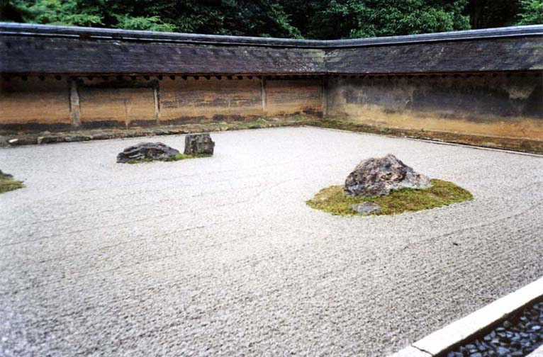 """KYOTO: View of the Ryoanji Temple sand garden, the most famous in Japan. Its 15 rocks cannot be viewed simultaneously except from above. Tradition says that though there are 15 large stones altogether, only the Buddha can see all 15 at once. The pebbles are raked in patterns suggesting water rippling around """"islands"""" of stone. """"Sand"""" gardens are actually made of gravel, and are intended as objects of meditation. May 16, 1998"""