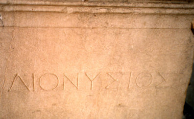 ATHENS: Did a sculpture of Dionysus once rest on this pedestal? It has his name carved on it.