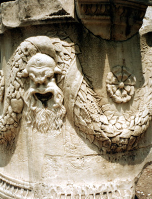 ATHENS: A carved comic mask on a Roman pillar