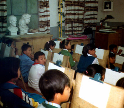 BEIJING: An art class just beginning a lesson. Busts of Julius Caesar and Voltaire in the background on the left.
