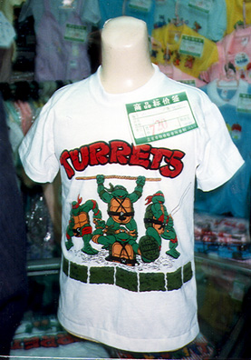 BEIJING: T-shirt in a Beijing department store, with a slightly garbled version of Teenage Mutant Ninja Turtles. May 25: much aimless running around, checking in with United Airlines, visit to very interesting historical museum, loaded with Shang bronzes, great pottery, early printing and books. I rushed through it to have time to pay one final brief visit to the Forbidden City--a long walk to the entrance--but I did get to explore some of its ancillary museums. We had trouble finding a place open for a late lunch, and finally gave up. Most of us were ready to skip a meal after the all the feasting we had done. May 26: up at 5:40 AM for the long trip home: a bus to airport, then flights to Shanghai, Tokyo, San Francisco, and Spokane.