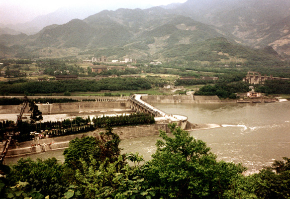 CHENG DU: The waterworks consist of a carefully engineered barrier in mid-stream at a fork in the river which diverts most of the water toward agricultural areas in times of low flow, but keeps excess water from flooding the fields in periods of high flow. The Russians built a modern dam to replace it, which turned out to not work as well, and has been abandoned.