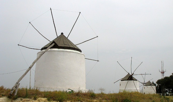 VEJER DE LA FRONTERA: Three old windmills, restored as a tourist attraction. In the background, the local broadcasting tower.