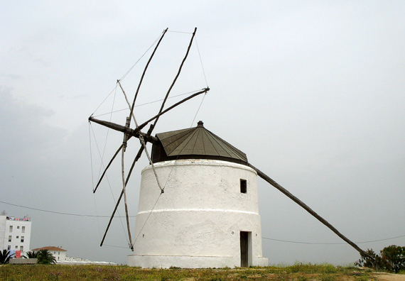 """VEJER DE LA FRONTERA: The Spanish are very conscious of their windmill heritage because of the famous scene in Don Quixote where the protagonist jousts with one under the delusion that it is a giant (hence the old English expression for combating imaginary evils: """"tilting at windmills."""" Unfortunately, we didn't see a single traditional windmill equipped with sails, actually working."""