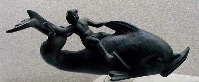 SELÇUK MUSEUM: But the most famous Eros in the collection is this bronze image of the boy riding on a dolphin (2nd C. CE). Reproductions are for sale all over.