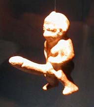SELÇUK MUSEUM: But by far the most popular exhibit is the tiny image of the similarly well-endowed Bes. Unfortunately, the glass case enclosing him defeated the camera's auto-focus mechanism. Phallic images like this were very popular all over the ancient world, used as good-luck symbols.
