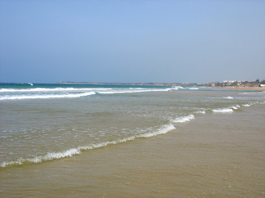 CONIL: The shore slopes gradually here, which means breakers you can wade into, and warm water.