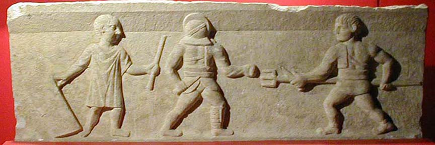 SELÇUK MUSEUM: Image from the tombstone of a gladiator. The Romans were entertained by combats involving differently armed (and protected) combatants like this.