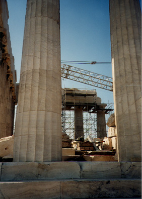 ATHENS: The cranes and scaffolds were present not so much to reconstruct the building as to undo earlier ruinous restorations. The exhaust fumes of Athens' automobiles and buses rapidly eat away the marble of this and other classical remains.