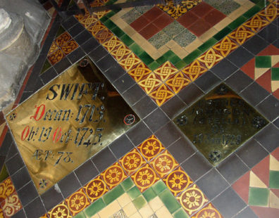 """DUBLIN, ST. PATRICK'S CATHEDRAL: Set into the floor near the entrance to the cathedral are the tombs of Swift and """"Stella."""""""