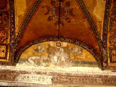 HAGIA SOPHIA: Hagia Sophia also contains several fine Medieval frescos. This image of Christ enthroned is painted in the lunette over the imperial doorway leading into the interior of the church. In the circles on either side are busts Mary and the Archangel Gabriel. The figure on the left is often identified as Leo VI the Wise (886-912) bowing before Christ. Such royal self-portraits were a way of glorifying the Emperor's power and wealth while simultaneously showing his piety, and were common in both the eastern and western churches.