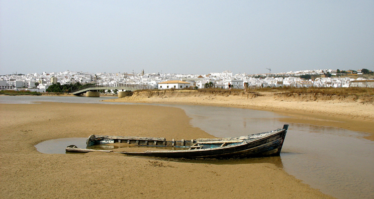 CONIL: For splendid isolation, head south across the bridge from Conil to Playa Fuente del Gallo where an old rowboat lies stranded in the sands.