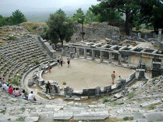 PRIENE: Priene had a small theater. See that rectangular object the guy with his shirt off is walking toward?