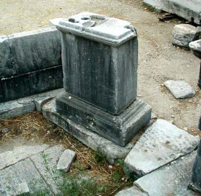 PRIENE: It's a clepsydra, or water clock, used to regular public debates. When the dripping water ran out the channel on the left and down the pillar, your speaking time was up. Don't ask how the water got in; that's all the guide told us.