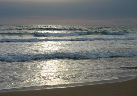 CONIL: At the end of the day, the sea was transformed, seeming to be illuminated by moonlight, though it was still the sun which was shining through thin clouds.