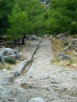 PRIENE: One of the things that made Roman civilization great was superior drains. This channel running down the street may look simple; but it's part of the secret of Roman success.