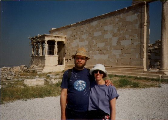ATHENS: Paula and Paul in front of the Erectheum porch of the Caryatids (replicas--the original sculptures have been removed to a museum).