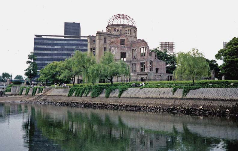 """HIROSHIMA: This commercial exposition hall was the only reinforced concrete structure at ground zero, and was left standing after the dropping of the atomic bomb. It has become a symbol of the bombing, and has actually been """"restored"""" to keep it in the precise state of ruin it was in 1945. Just to the right of the dome is visible a bank of lights for the adjacent baseball stadium. Hiroshima is a very modern city. May 17, 1998"""