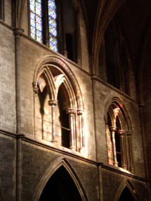 DUBLIN, ST. PATRICK'S CATHEDRAL: During the service, the rays of the setting sun cast colored light through the windows on the stone walls.
