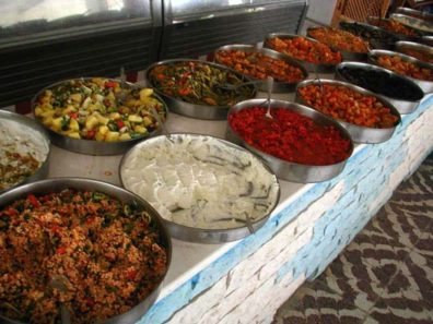 MILETUS: Our guide book warned about high-priced restaurants set up to serve tourist groups nearby. Lunch was included in the tour, so we don't know what it cost; but we would have gladly paid a handsome sum for this lavish spread. These are just a few of the delicious dishes offered at the huge buffet. That white stuff is garlicky sautéed green beans smothered in high-fat, high-density yogurt. Yum!