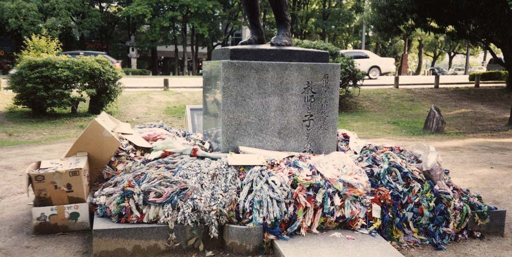 HIROSHIMA: Thousands of folded paper cranes are sent by school children to Hiroshima every day where they are placed on several statues. Here some cartons of them have been rather unceremoniously dumped at the foot of a sculpture of a mother holding her dead children. May 17, 1998