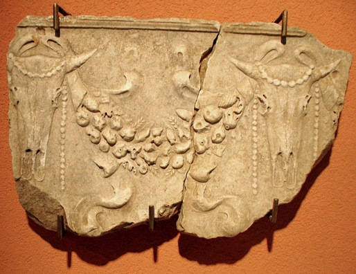 CADIZ: Roman relief with cow skulls and garland of fruit. In the Museum of Fine Art and Archaeology, Cadiz.