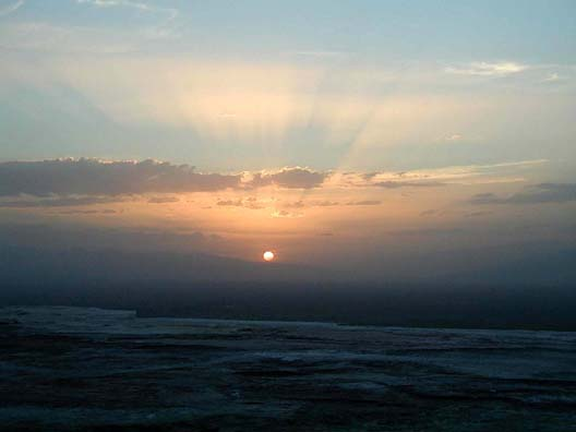 PAMUKKALE: Sunset over the cliffs viewed from the top.
