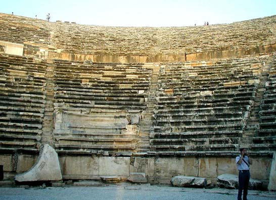HIEROPOLIS: To get some idea of how vast this theater is, look at the tiny figures standing on the rim at the top. It might have held as many as 12,000 spectators when Hieropolis was a thriving city.
