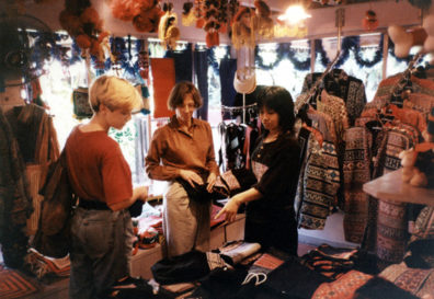 Paula (right) and Megan (left) bought elegant outfits in this Hmong shop for a fraction of what it would have cost at home. Nearby Megan and I also bought identical Tintin t-shirts.