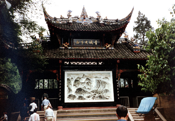 QINGSHEN: Many people were offering prayers, accompanied by a ringing gong. A color TV was playing a soap opera in one corner of the temple. We learned that the bat symbol means happiness.