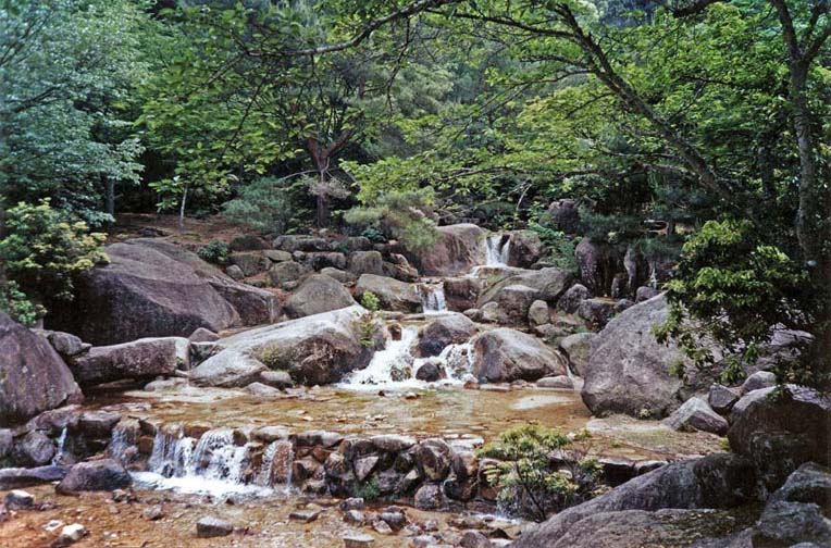 MIYAJIMA: Note the Japanese penchant for improving on nature--an artificial cascade has been added to this stream in the foreground. Taken along the path to the chairlift up Mt. Mizen on Miyajima Island, one of the famed beauty spots of Japan. May 18, 1998