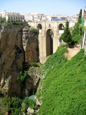 RONDA: A bridge takes visitors high over the stream below.