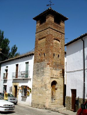 RONDA: A rare surviving Moorish minaret, c. 14th C. The arch over the doorway is of distinctively Morish design. Now attached to private dwellings. It was converted into the belltower of a Christian Church devoted to St. Sebastian in the Christian era.