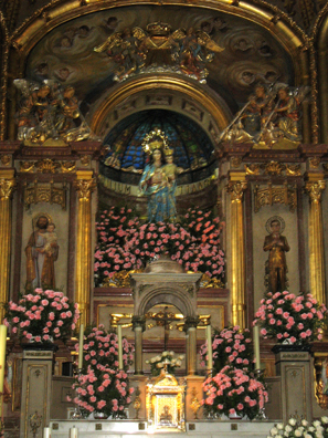 RONDA: The altar inside was covered with pink flowers.