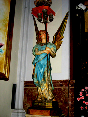 RONDA: A charming angel beside the altar